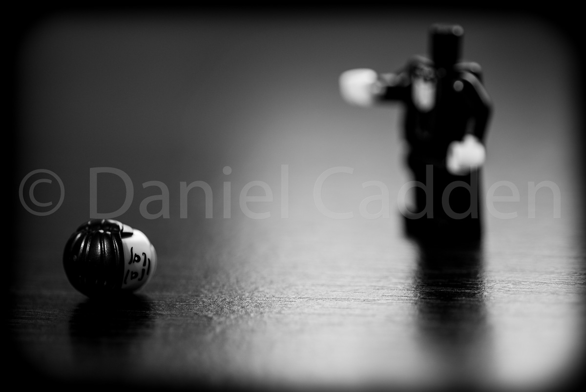 A photograph of a lego character with a missing head