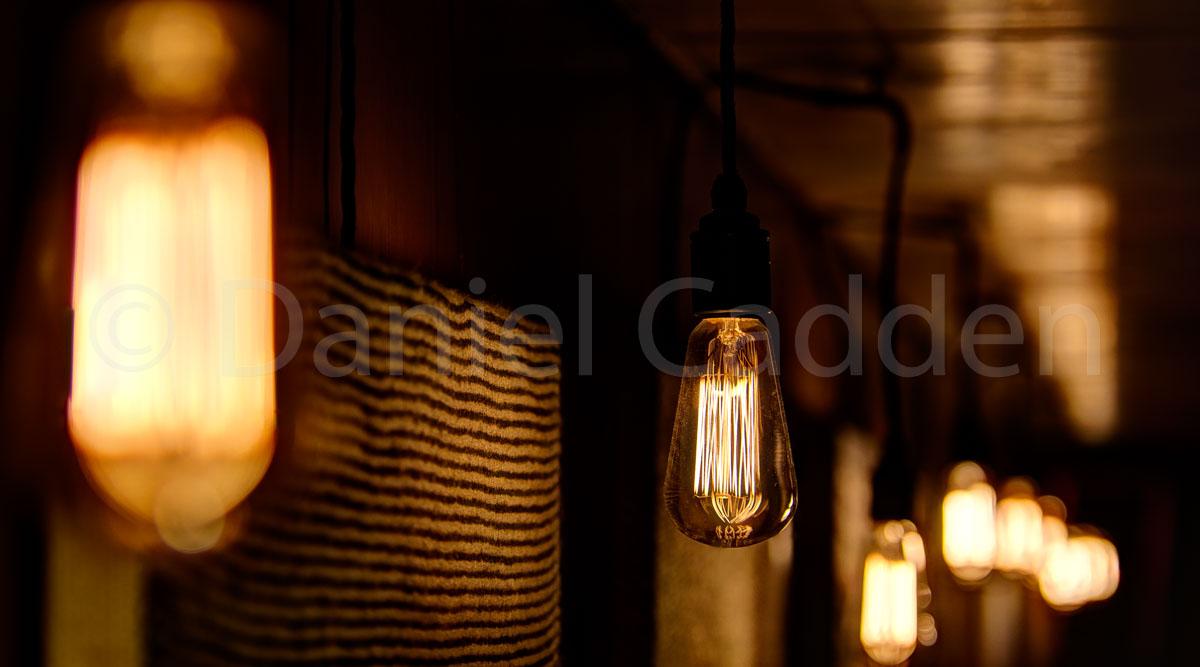 Photograph of a string of electric light bulbs taken inside Chorlton's Electrik Bar